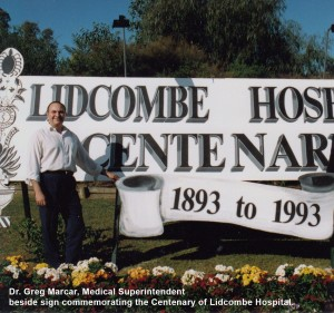 Dr. Greg Marcar, Medical Superintendent  beside sign commemorating the Centenary of Lidcombe Hospital